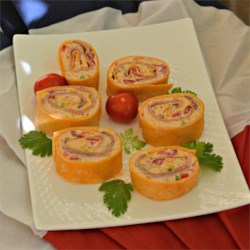 Taco Turkey Wraps Recipe - Taco seasoning and Mexican cheese blend gives these turkey wraps a south-of-the-border-inspired flair perfect as appetizer bites.