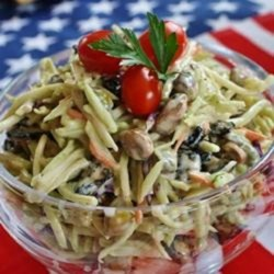 Broccoli Slaw Recipe and Video - Broccoli with creamy dressing, dried cranberries and pistachios.