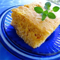 Applesauce Cornbread Recipe - This is an easy, quick recipe for cornbread that's dense, and adjustably sweet. It will smell great as it bakes and comes out with a great golden crust. It can accompany anything. I love it served with salad, soup, or chili.  Add herbs for extra flavor.