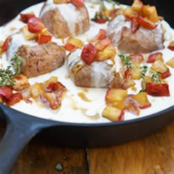 Pork Tenderloin with Caramelized Apple and Creme Sauce Recipe - Fresh thyme, dry white wine, and carmelized apple give this weeknight dinner gourmet flavour.