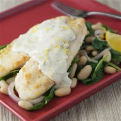 Tilapia Fillets with Tuscan White Bean & Spinach Salad Recipe - Perfect for a light dinner, this typical Tuscan white bean and spinach salad is topped with a breaded tilapia fillet and lemony cream sauce.