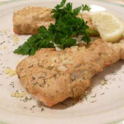 Cedar Planked Salmon with Dill Recipe - A grilled salmon fillet slathered with a zippy sauce of mustard, mayo, dill, and garlic makes a perfect outdoor meal.