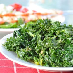 Mediterranean Kale Recipe - Steamed kale is tossed in a bright and lemony dressing in this easy side dish.