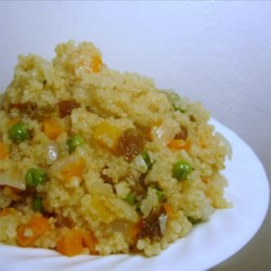 Quick Couscous with Raisins and Carrots Recipe - Couscous is cooked with onion, diced carrots, and raisins for a quick, colorful side dish with a Mediterranean flair.