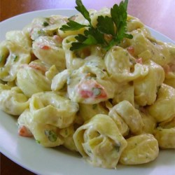 Tortellini and Artichoke Salad Recipe - Tortellini and marinated artichoke hearts are tossed in a creamy, reduced-fat dressing that is a quick and easy dinner or picnic side dish.