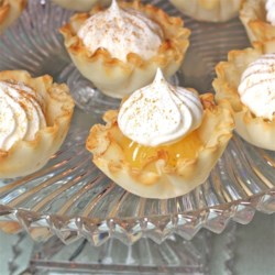 Lemon Curd Tarts Recipe - Using frozen prepared miniature phyllo tart shells and prepared lemon curd make these delightful bite-size treats and quick and easy tea accompaniment.