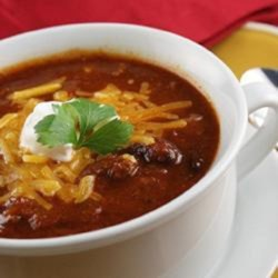 Jammin' Tarheel Chili Recipe - Ground beef, chili beans and kidney beans are the bulk of this spicy tomato based chili spiced with cumin and coriander.
