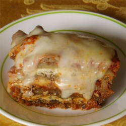 Jorge's Pasta-less Eggplant Lasagna Recipe - This twist on lasagna replaces noodles with broiled eggplant slices. The traditional mozzarella cheese is replaced with feta cheese.