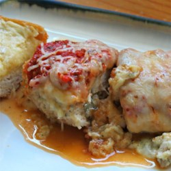 Italian Stuffed Chicken Breast Recipe - Italian-inspired stuffed chicken breasts are loaded with plenty of cheese and seasonings and baked with spaghetti sauce for a crowd-pleasing meal.