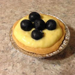 Mango Cheese Tart with Blueberries Recipe - This yummy tart was my mums recipe. A shortdough crust filled with mango cream cheese and piled high with blueberries. Serve chilled for a great summer dessert.