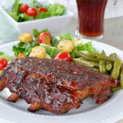 Steve's Bodacious Barbecue Ribs Recipe - These make real mouth-watering 'Pig-cicles'! They take a while to cook, and when you eat them, you'll have pork fat smeared from ear to ear! Mmm! Mmm! I like to smoke with hickory wood, but any of your favorite will suffice.