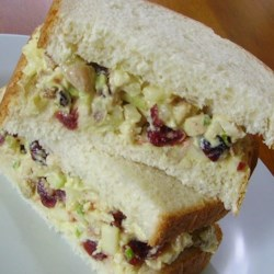 Curried Chicken Tea Sandwiches Recipe - With apples and dried cranberries for color and tang, this dressed-up chicken salad is wonderful on bread triangles or served on a lettuce leaf.