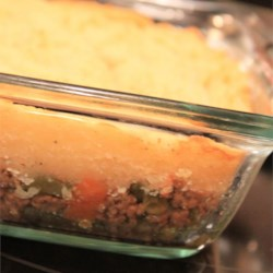 Turkey Shepherd's Pie Recipe - Ground turkey is sauteed in olive oil along with shredded carrot,mushrooms, garlic, and seasonings. This tasty filling is then piled into a baking dish, topped with homemade mashed potatoes, and baked until golden.