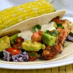 Quick Fish Tacos Recipe - Tilapia fillets are pan-fried in a jalapeno-infused oil and served with a quick cabbage slaw. For a milder flavor, remove the seeds from jalapeno peppers before adding to the slaw.