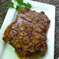 Cuban Marinated Steak Recipe and Video - Rib eye steaks marinate in orange juice, toasted cumin seeds, and a few other seasonings before hitting the grill briefly for delicious, flavorful seared meat.
