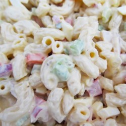 The BEST Macaroni Salad You Will EVER Have!! Recipe - This fusion of macaroni and tuna salad also uses cucumber, onion, and tomato for a delicious picnic salad everyone will love.