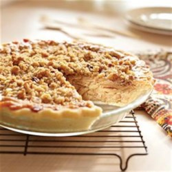 Caramel Apple Walnut Pie Recipe - Apples in a sweet, creamy base are topped with a walnut crumble and baked until apples are tender and topping is golden brown.