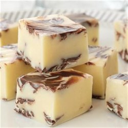 Chocolate Swirled Peppermint Fudge Recipe - Chunks of minty chocolate are sprinkled liberally throughout this easy white fudge.