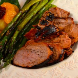 Marinated Grilled Pork Tenderloin Recipe - Pork tenderloin is marinated with soy sauce, oyster sauce, honey, and ginger in this easy outdoor dish. Serve it with your favorite salad for a tasty dinner.