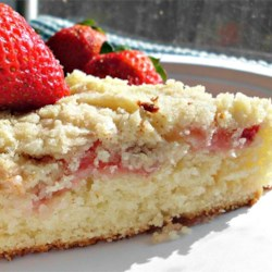 Fresh Strawberry Coffee Cake Recipe - Impress your guests with this white coffee cake topped with strawberries and a coconut topping.