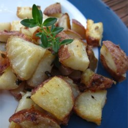 Kristen's Parmesan Roasted Potatoes Recipe - Parmesan and thyme flavor these golden brown, cubed potatoes!