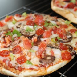 Pita Pizza Recipe and Video - All you need is mozzarella cheese, sliced veggies, olive oil, pita pockets, and a grill. Brush the pita with oil, layer on the veggies and cheese, and then grill until the pita is crisp, the veggies are tender and the cheese is melted.