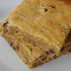 Peanut Butter Bars IV Recipe - This recipe forms a rather stiff dough, you might have to press it in the pan.  One time I put raisins in the batter by mistake, and my husband loved them that  way. You can also omit the chocolate chips and have them plain if you wish.