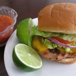 Fantastic Chicken Burgers Recipe - Guacamole seasoning mix, fresh lime juice, and cilantro are the flavor secrets to spice up grilled chicken burgers. 