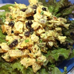 Curry Chicken Salad with Grapes Recipe - Curry chicken salad with grapes, almonds, and parsley is a nice salad topper, filling for a croissant, or a snack simply eaten with a fork.