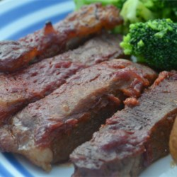 Baked Round Steak in Barbeque Sauce Recipe - Thick-cut strips of round steak are baked in a tangy, mouthwatering barbeque sauce in this family-tested recipe that was passed down through the generations.