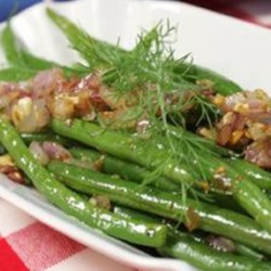 Dilled Green Beans Recipe - Fresh, whole green beans are cooked in butter with onion, garlic, and fresh dill and topped with chopped hard-boiled eggs for a summery side dish.