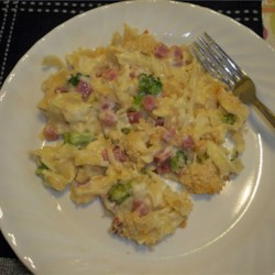 Ham and Noodle Casserole Recipe - Tender egg noodles, cubes of ham, and Swiss cheese give this creamy casserole plenty of flavor.