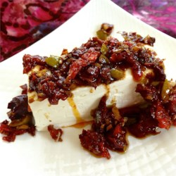 Sundried Tomato Tapenade Recipe - Add sun-dried tomatoes to traditional olive tapenade and spoon over cream cheese for a crowd-pleasing appetizer. Serve with your favorite crackers.