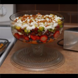 Eight-Layer Fruit Salad Supreme Recipe - A colorful variety of fruit is layered between lime-honey syrup and cream cheese filling in a trifle bowl for a beautifully presented dish for any special occasion.