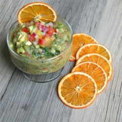 Fruit Salsa Recipe - Like a cool breeze on a hot summer day at the beach, this flavorful fruit salsa is zesty and refreshing! Serve it with tortilla chips.