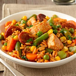 Quick Chicken Paella Recipe - Chunks of chicken and chorizo slices are cooked with a colorful blend of veggies until just done, then blended with white rice and broth for a quick and tasty weeknight dinner.
