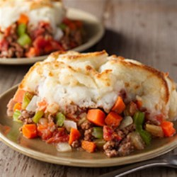 Shepherd's Pie from Birds Eye(R) Recipe - Browned ground beef, diced tomatoes, and mixed veggies are simmered on the stove, then placed in a casserole, topped with prepared mashed potatoes, and baked until golden for this easy, comfort-food classic.
