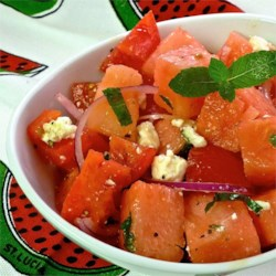 Tomato Watermelon Salad Recipe - Tomatoes and watermelon are a match made in heaven in this summertime pleaser.
