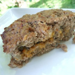 Super Stuffed Meatloaf Recipe - This meatloaf is stuffed with a mixture of Cheddar cheese, and sauteed onions and mushrooms.