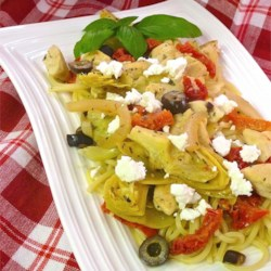 Chicken with Artichokes and Sundried Tomatoes Recipe - Angel hair pasta topped with chicken, artichoke hearts, sun-dried tomatoes, and feta cheese is a quick and delightful dinner.