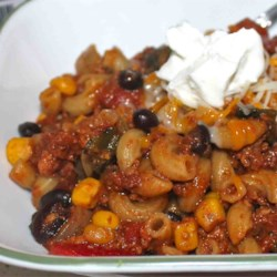 Chili Mac, Mexican Style Recipe - In this version, Chili Mac gets even closer to its roots with authentic Mexican ingredients like chorizo and poblano peppers. It's quick and easy--a true one-pot meal. Serve in bowls, and garnish with small dollops of sour cream or a sprinkling of queso anejo.