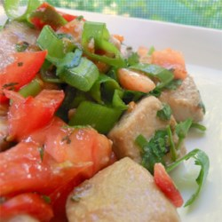 Thai Tuna Salad Recipe - Fresh tuna is marinated in a sweet marinade of fish sauce, lime juice, and honey, stir-fried, and then tossed with garden fresh tomatoes, basil, and cilantro. A small, red chile pepper adds spice to this warm tuna salad.