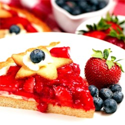 Fresh Strawberry Cheesecake Pie Recipe - Fresh strawberries in a sweet glaze top a baked cream cheese filling in this delightful deep-dish pie.