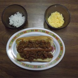 Not so Sloppy Hot Dogs Recipe - Hot dogs are layered with a homemade sloppy joe-type topping that is a little less sloppy than the traditional sandwich.