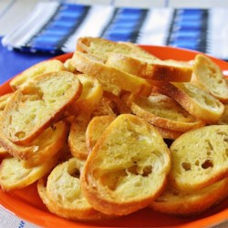 Crostini D'Emily Recipe - Tiny toasts to serve with a festive dip or baked garlic!