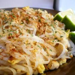 Authentic Pad Thai Recipe and Video - Inspired by the pad thai at Thai Tom, this recipe features a tamarind paste, vinegar, sugar, and fish sauce mixture over perfectly stir-fried eggs, chicken breast, and rice noodles, garnished with peanuts, chives, and fresh bean sprouts.