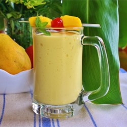 Easy Mango Banana Smoothie Recipe - Mangos and bananas are blended with milk and yogurt creating a quick and easy snack or breakfast.