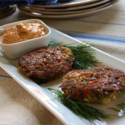 Cajun Crab Cakes (No Breadcrumbs) Recipe - These Creole-spiced crab cakes make a delicious side dish or appetizer. The key is to use a small amount of crumbled crackers instead of breadcrumbs for a lighter, less-starchy cake.