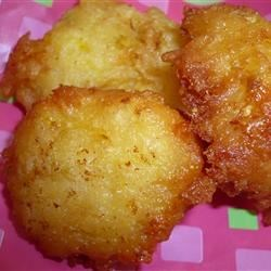Summer Squash Puffs Recipe - Delectable summer squash is combined with corn muffin mix and fried into tasty little fritters.