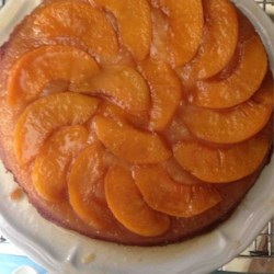 Peach Upside Down Cake II Recipe - This citrus-flavored cake recipe features a layer of cherries and canned peaches for a delicious spin on the pineapple-flavored classic.